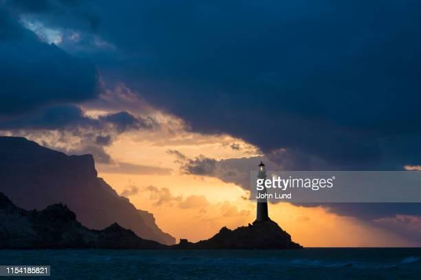 beautiful lighthouse at sunset - paesaggio marino foto e immagini stock