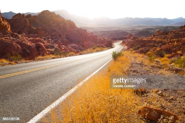 beautiful lit road - nevada photos et images de collection