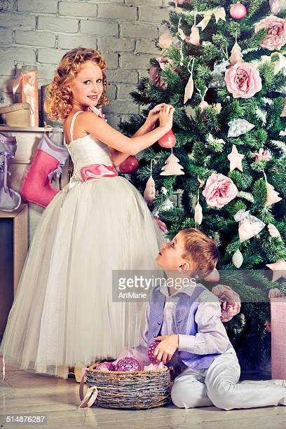 Beautiful little boy and girl decorating Christmas tree
