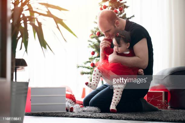 beautiful little girl at first christmas party - new year's day stock pictures, royalty-free photos & images
