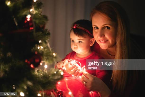 beautiful little girl at first christmas party - embellishment stock pictures, royalty-free photos & images