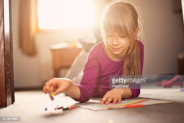 Beautiful little girl drawing