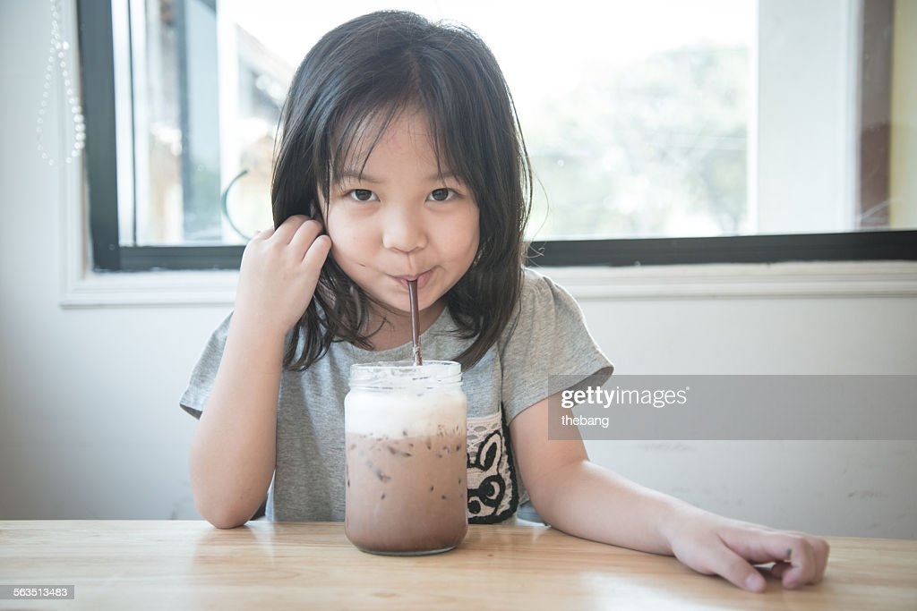 Beautiful Little Girl Drinking Chocolate Milk Stock Photo Getty Images