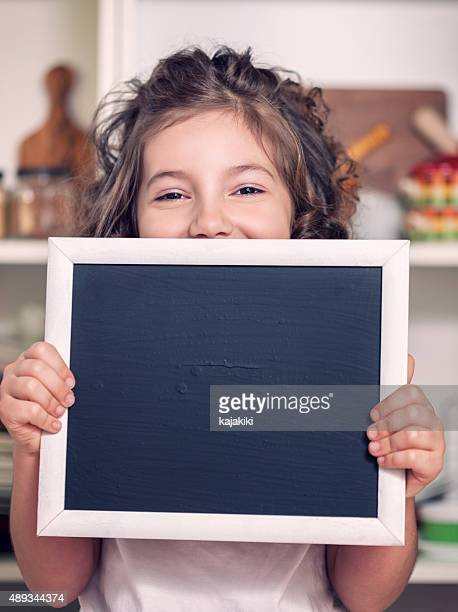 Beautiful Little Girl Holding Blank Blackboard