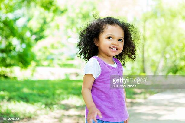 Beautiful little girl in the park on a sunny day