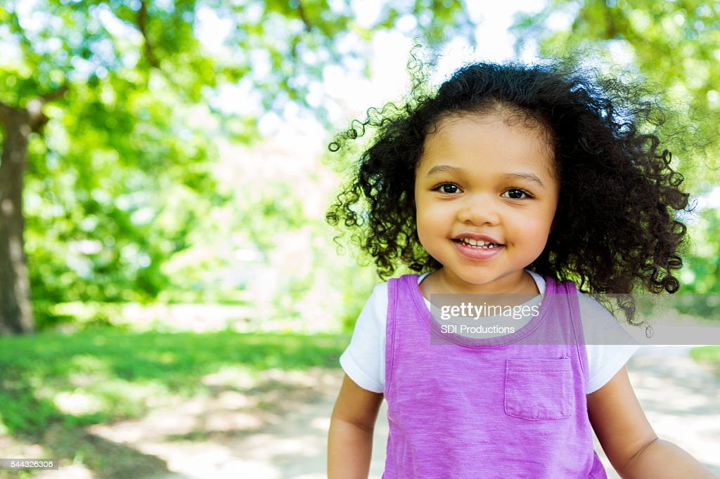 Beautiful little girl in the park : Stock Photo