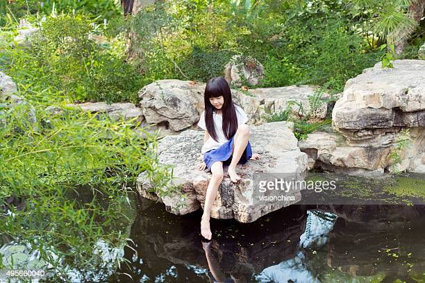 beautiful little girl playing in a pond - up skirt stock photos and pictures