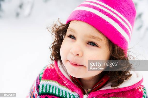 Beautiful Little Girl Playing in the Snow Wearing Pink Hat