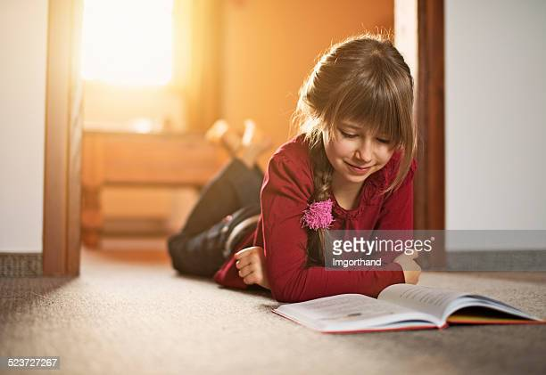 Beautiful little girl reading