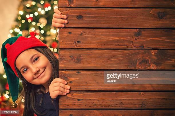 Beautiful Little Girl With Blank Wooden Board