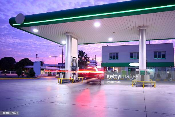 beautiful long exposure photograph of a refueling station - convenience store stock photos and pictures