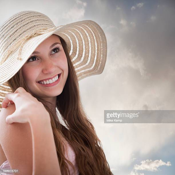 beautiful long haired woman daydreaming - charming stock pictures, royalty-free photos & images
