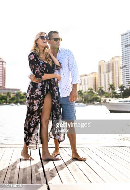 beautiful luxury couple oceanfront on a dock - west palm beach stock pictures, royalty-free photos & images