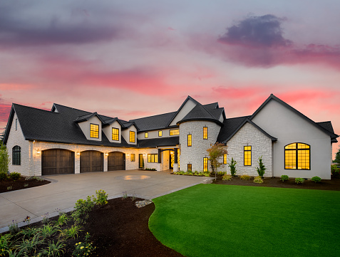 Beautiful luxury home exterior at sunset 1054759884