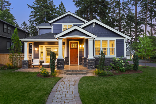 Beautiful luxury home exterior at twilight 1026205392
