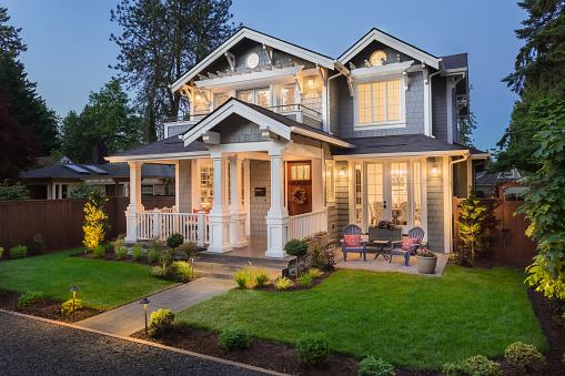 Beautiful luxury home exterior at twilight 1066000176