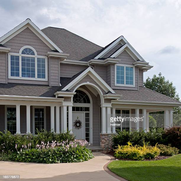 beautiful luxury home exterior - front view photos stock photos and pictures
