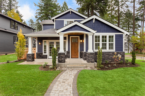 Beautiful Luxury Home Exterior with Green Grass and Landscaped yard 856794670