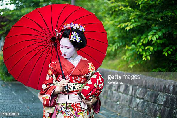 beautiful maiko in the streets of kyoto - kimono stock pictures, royalty-free photos & images
