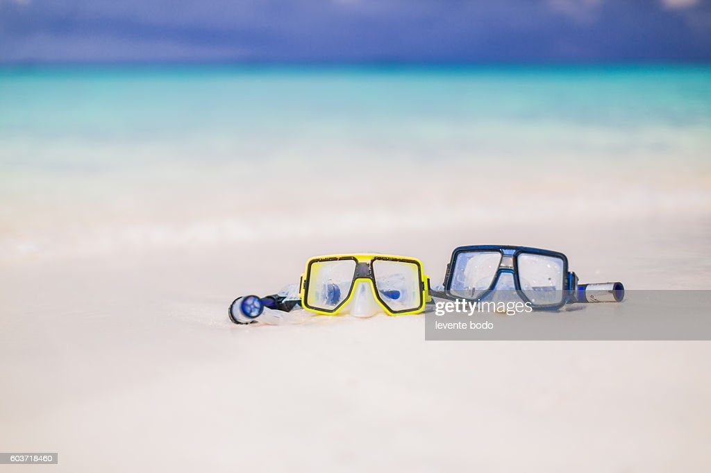 Beautiful Maldives beach with two snorkel mask. Romantic beach background. : Stock Photo