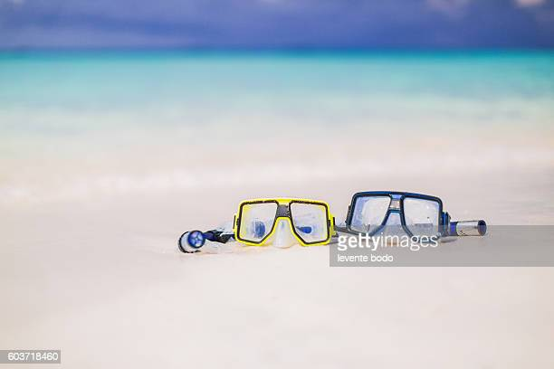 Beautiful Maldives beach with two snorkel mask. Romantic beach background.