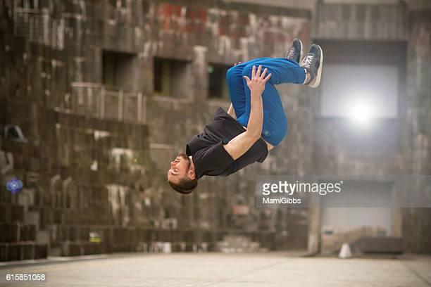 Beautiful male dancer break-dancing on the street