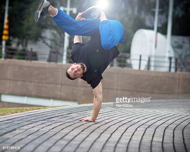 Beautiful male dancer exercise on the street