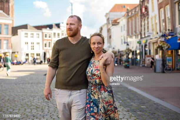 beautiful man and woman tourist couple in gouda - north rhine westphalia stock pictures, royalty-free photos & images