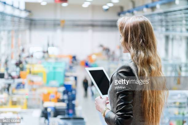 beautiful manager in plastic factory with tablet - beautiful czech women stock photos and pictures