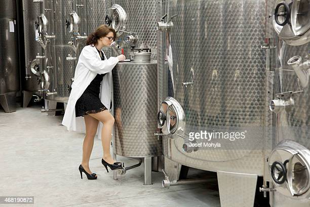 Beautiful manageress when checking in chemical manufacturing