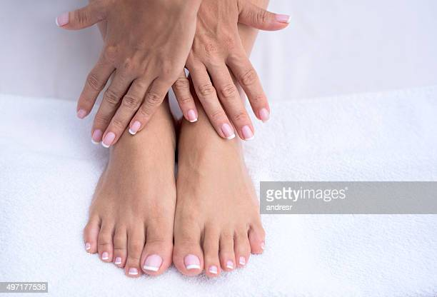 beautiful manicure and pedicure - beautiful female feet stock photos and pictures