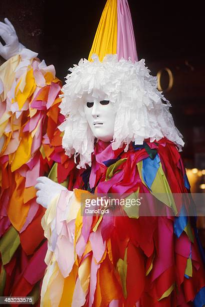 Beautiful mask parading in Venice: coloured dress and white face