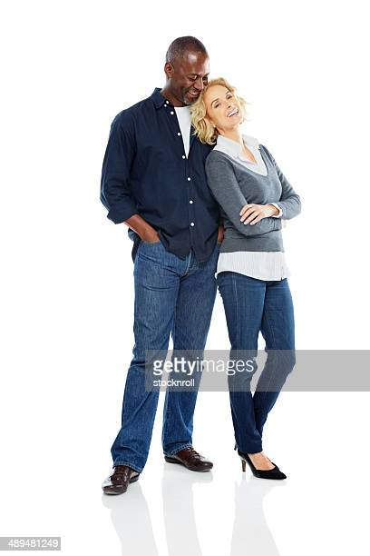 Beautiful mature couple standing relaxed on white