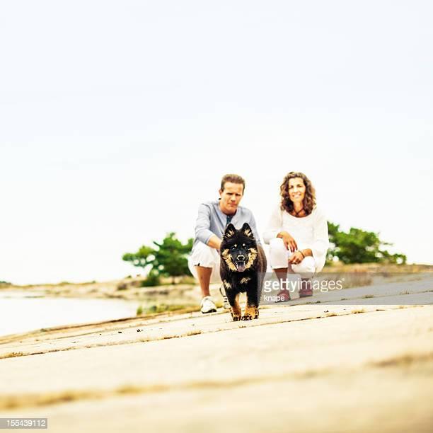Beautiful mature couple with dog