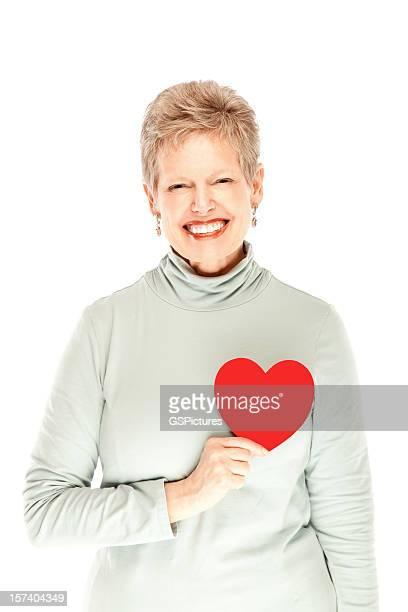 Beautiful mature female holding heart smiling