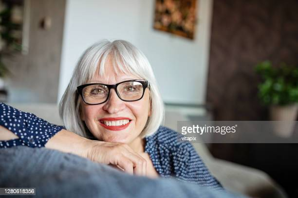 beautiful mature woman - toothy smile stock pictures, royalty-free photos & images
