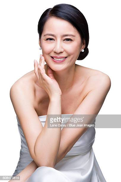beautiful mature woman - asian 50 to 55 years old woman stock photos and pictures