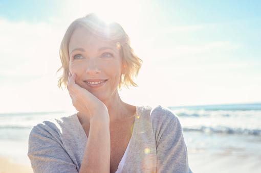 Beautiful mature woman portrait on the beach. 961624412
