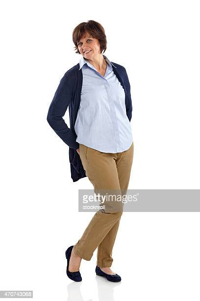 Beautiful mature woman posing in casuals over white