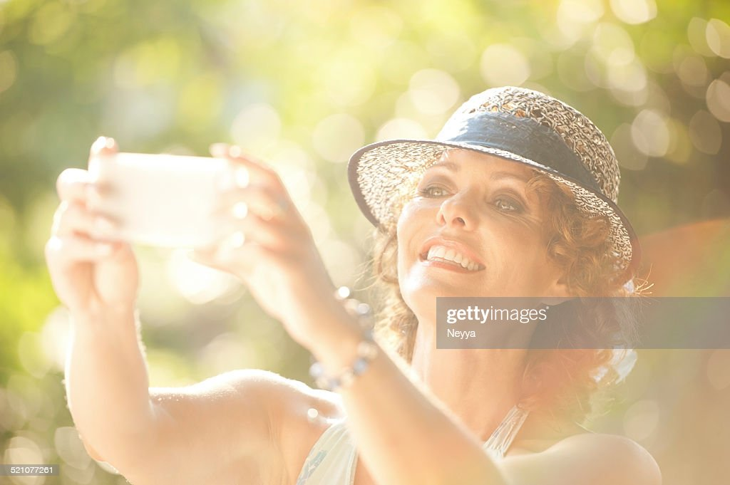 Beautiful Mature Woman Taking Selfie In The Park Stock Photo  Getty Images-2692