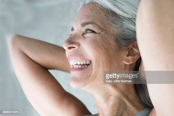 beautiful mature woman with hands behind head - gray hair stock pictures, royalty-free photos & images