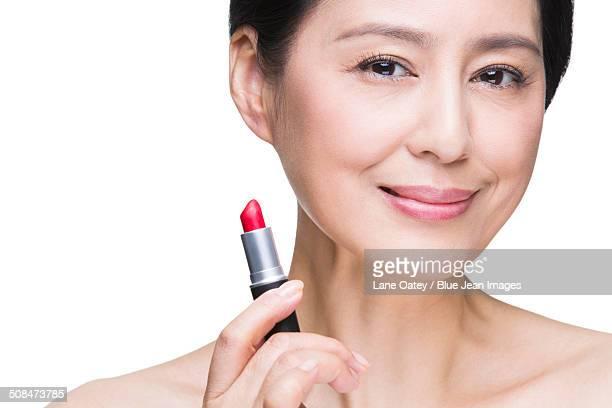 Beautiful mature woman with lipstick