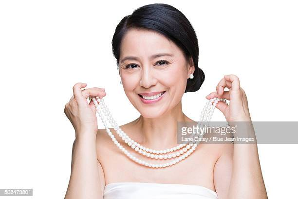 Beautiful mature woman with pearl jewelries