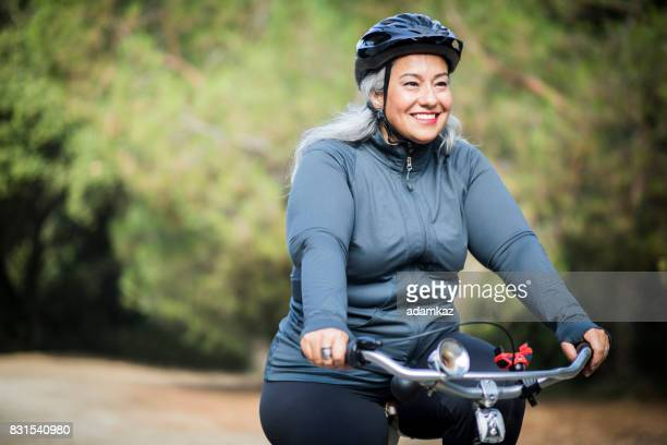 beautiful mexican woman biking - dieting stock pictures, royalty-free photos & images