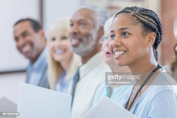 Beautiful mid adult woman attends continuing education class