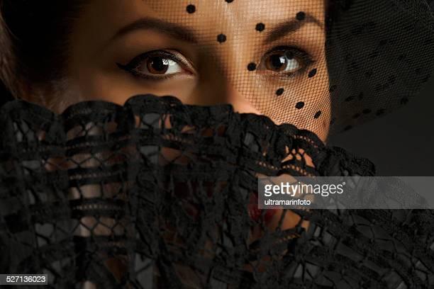 Beautiful mid adult women   Holding folding fan  Glamourous retro diva