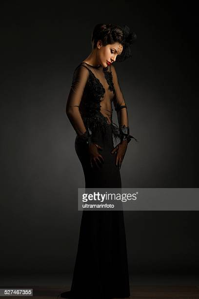 Beautiful mid adult women wearing black gown  Glamourous retro diva