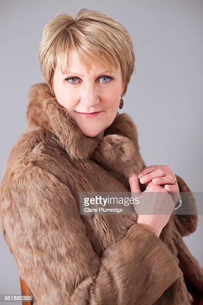 beautiful middle age woman in a fur coat - ウェスト・バークシャー ストックフォトと画像