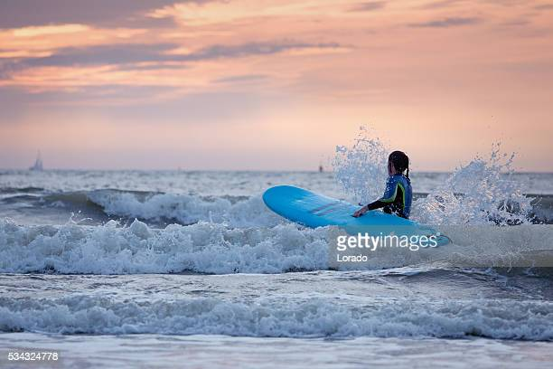 Beautiful middle aged female surfing in the North Sea