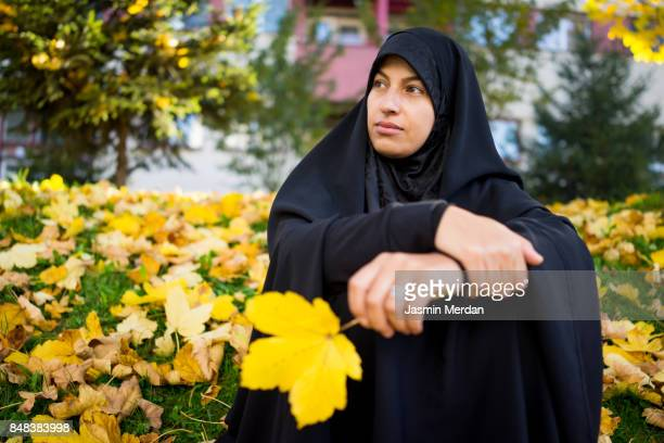 beautiful middle eastern woman in autumn park - iranian culture stock photos and pictures